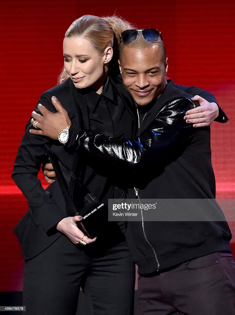 Recording artists Iggy Azalea (L) and T.I. accept the Favorite Rap/Hip-Hop Album award for 'The New Classic' onstage at the 2014 American Music Awards at Nokia Theatre L.A. Live on November 23, 2014 in Los Angeles, California.