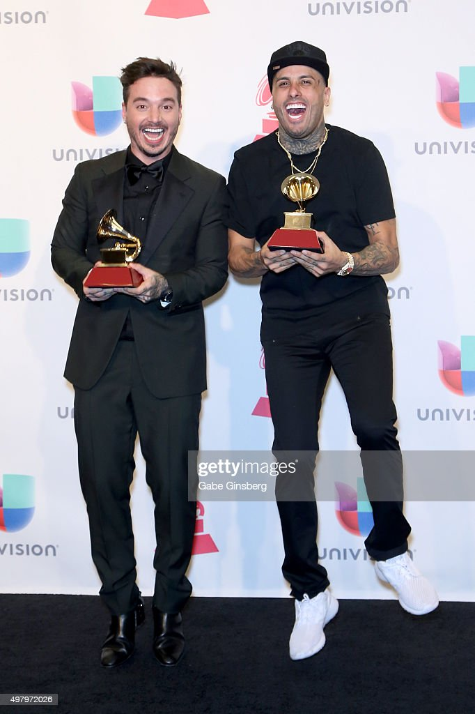 Recording artists J Balvin and Nicky Jam pose backstage with the award for the Best Urban Song, 'Ay Vamos' in the press room during the 16th Latin GRAMMY Awards at the MGM Grand Garden Arena on November 19, 2015 in Las Vegas, Nevada.