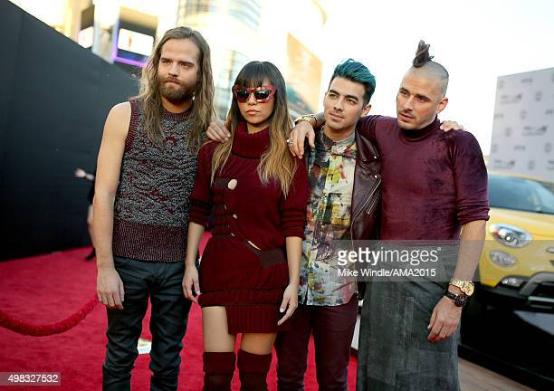 Recording artists Jack Lawless JinJoo Lee Joe Jonas and Cole Whittle of music group DNCE attend the 2015 American Music Awards at Microsoft Theater...