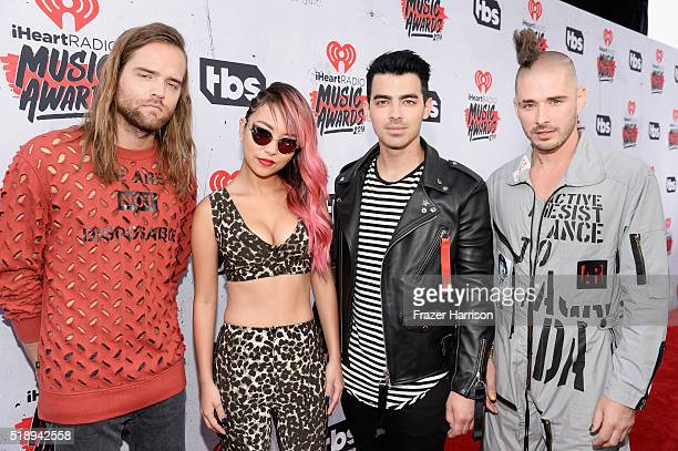 Recording artists Jack Lawless JinJoo Lee Joe Jonas and Cole Whittle of DNCE attend the iHeartRadio Music Awards at The Forum on April 3 2016 in...