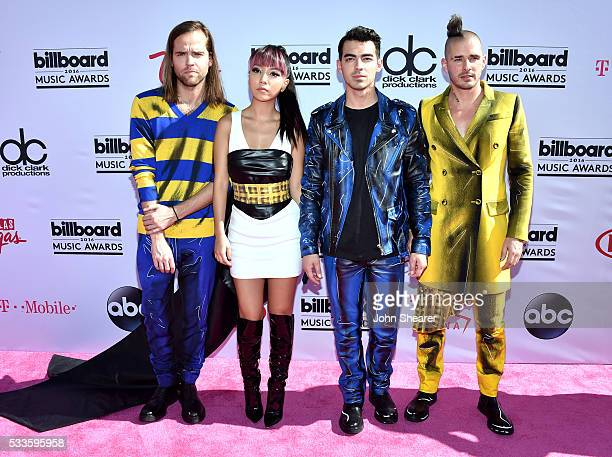 Recording artists Jack Lawless JinJoo Lee Joe Jonas and Cole Whittle of music group DNCE attend the 2016 Billboard Music Awards at TMobile Arena on...