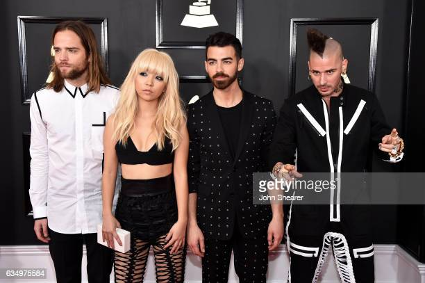 Recording artists Jack Lawless JinJoo Lee Joe Jonas and Cole Whittle of music group DNCE attend The 59th GRAMMY Awards at STAPLES Center on February...
