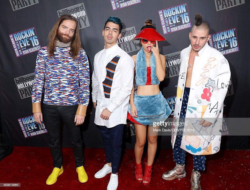 Recording artists Jack Lawless, Joe Jonas, JinJoo Lee and Cole Whittle of DNCE attend Dick Clark's New Year's Rockin' Eve with Ryan Seacrest 2016 on December 31, 2015 in Los Angeles, CA.