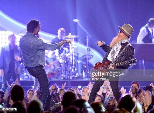 Recording artists Jake Owen and Billy Gibbons of ZZ Top perform onstage during the American Country Awards 2013 at the Mandalay Bay Events Center on...