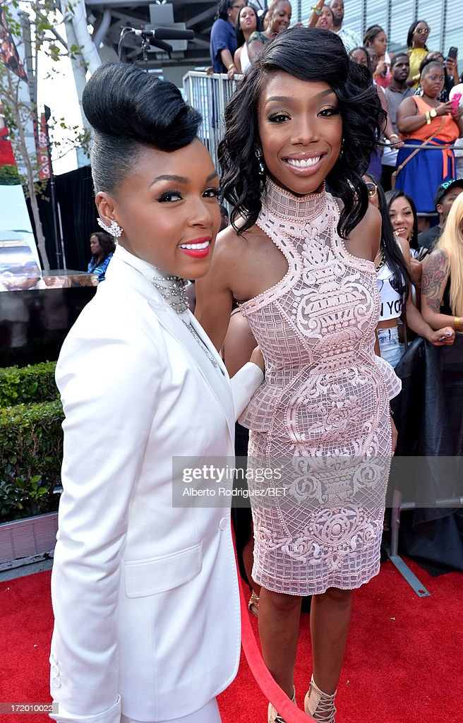 Recording artists <a gi-track='captionPersonalityLinkClicked' href=/galleries/search?phrase=Janelle+Monae&family=editorial&specificpeople=715847 ng-click='$event.stopPropagation()'>Janelle Monae</a> (L) and Brandy attend the P&G Red Carpet Style Stage at the 2013 BET Awards at Nokia Theatre L.A. Live on June 30, 2013 in Los Angeles, California.