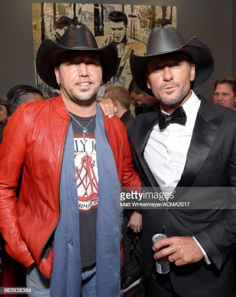 Recording artists Jason Aldean and Tim McGraw attend the 52nd Academy Of Country Music Awards at TMobile Arena on April 2 2017 in Las Vegas Nevada