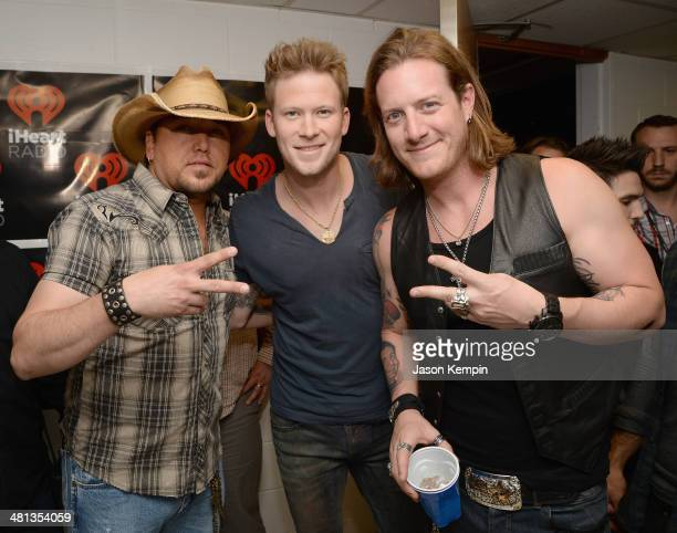 Recording artists Jason Aldean Tyler Hubbard and Brian Kelley attend iHeartRadio Country Festival in Austin at the Frank Erwin Center on March 29...