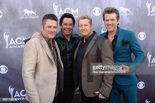 Recording artists Jay DeMarcus Gary LeVox and Joe Don Rooney of music group Rascal Flatts attend the 49th Annual Academy of Country Music Awards at...
