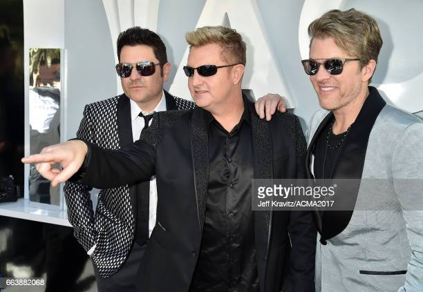 Recording artists Jay DeMarcus Gary LeVox and Joe Don Rooney of Rascal Flatts attend the 52nd Academy Of Country Music Awards at Toshiba Plaza on...