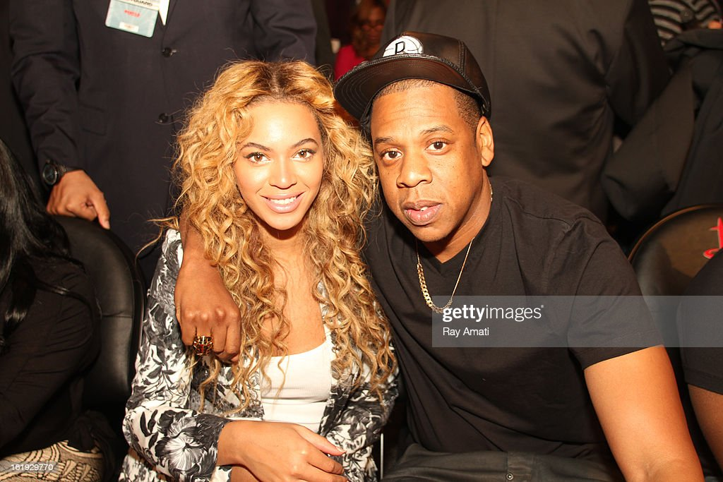Recording artists Jay Z and Beyonce pose for a photo during the 2013 NBA All-Star Game during All Star Weekend on February 17, 2013 at the Toyota Center in Houston, Texas.