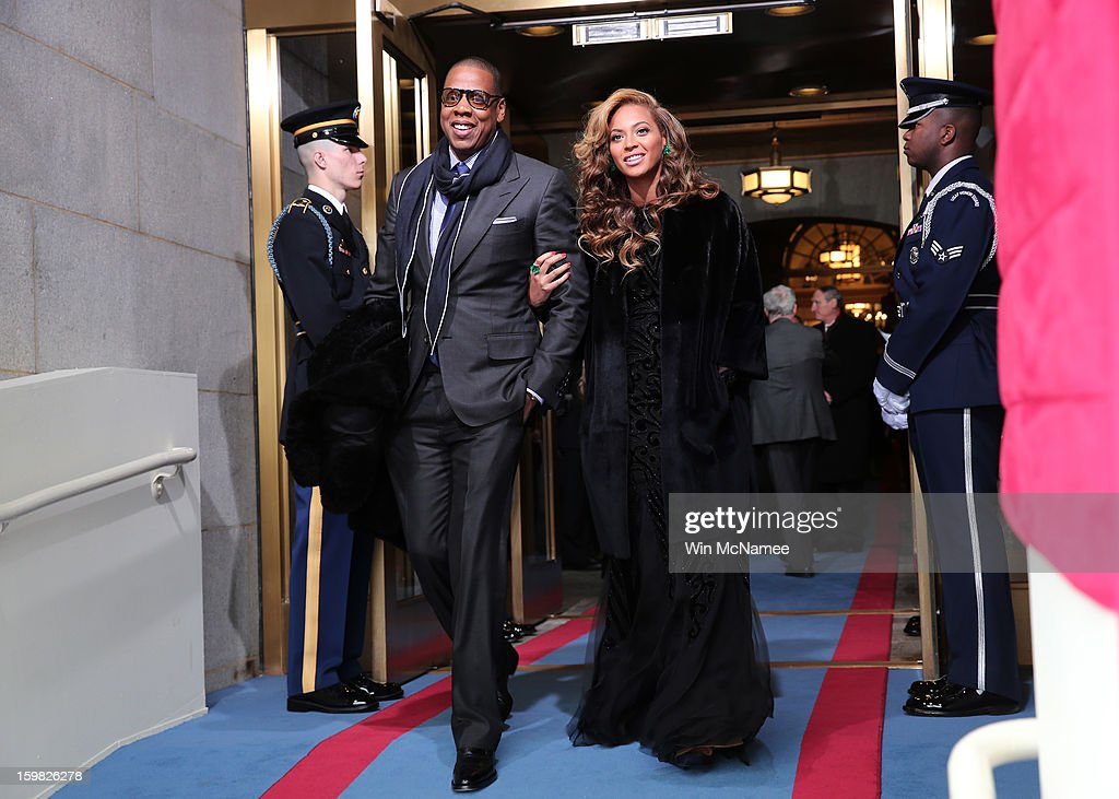 Recording artists <a gi-track='captionPersonalityLinkClicked' href=/galleries/search?phrase=Jay-Z&family=editorial&specificpeople=201664 ng-click='$event.stopPropagation()'>Jay-Z</a> and Beyonce arrive at the presidential inauguration on the West Front of the U.S. Capitol January 21, 2013 in Washington, DC. Barack Obama was re-elected for a second term as President of the United States.