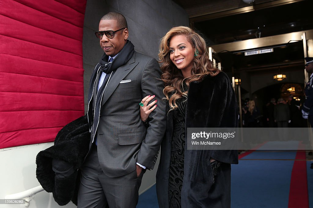 Recording artists Jay-Z and Beyonce arrive at the presidential inauguration on the West Front of the U.S. Capitol January 21, 2013 in Washington, DC. Barack Obama was re-elected for a second term as President of the United States.