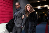 Recording artists JayZ and Beyonce arrive at the presidential inauguration on the West Front of the US Capitol January 21 2013 in Washington DC...