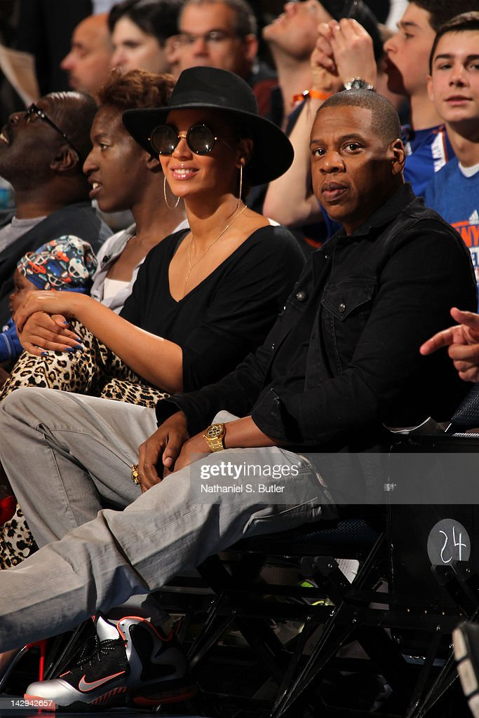 Recording artists <a gi-track='captionPersonalityLinkClicked' href=/galleries/search?phrase=Jay-Z&family=editorial&specificpeople=201664 ng-click='$event.stopPropagation()'>Jay-Z</a>, right, and <a gi-track='captionPersonalityLinkClicked' href=/galleries/search?phrase=Beyonce+Knowles&family=editorial&specificpeople=171204 ng-click='$event.stopPropagation()'>Beyonce Knowles</a>, left, attend a game between the Miami Heat and New York Knicks on April 15, 2012 at Madison Square Garden in New York City.