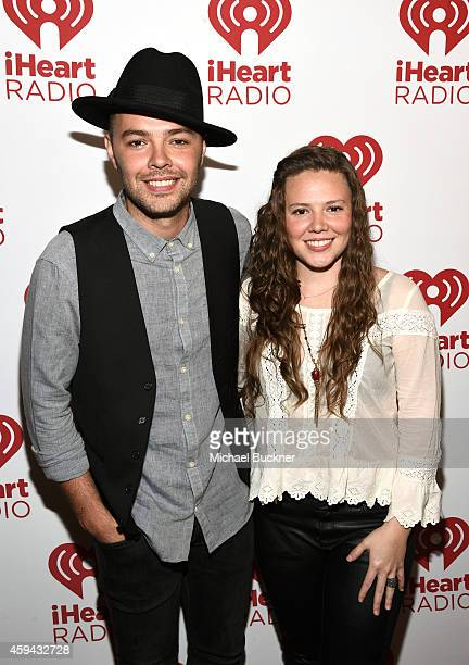 Recording artists Jesse Huerta and Joy Huerta of music group Jesse y Joy attend the iHeartRadio Fiesta Latina festival presented by Sprint at The...