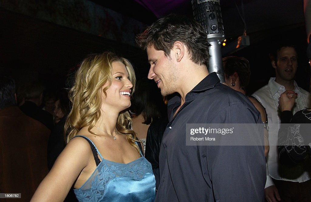 Recording artists <a gi-track='captionPersonalityLinkClicked' href=/galleries/search?phrase=Jessica+Simpson&family=editorial&specificpeople=171513 ng-click='$event.stopPropagation()'>Jessica Simpson</a> (L) and husband Nick Lachey attend the unveiling of GQ Magazine's Hollywood Issue at the GQ Lounge at White Lotus on February 20, 2003 in Hollywood, California. The party was the official kick-off to the GQ Lounge, a GQ designed nightclub that brings the pages of the magazine to life for one week.
