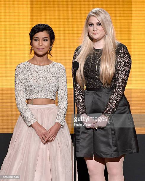 Recording artists Jhene Aiko and Meghan Trainor speak onstage at the 2014 American Music Awards at Nokia Theatre LA Live on November 23 2014 in Los...