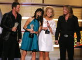 Recording artists Jimi Westbrook Karen Fairchild Kimberly Roads and Phillip Sweet of the band Little Big Town accept their award for 'Top New Duo or...