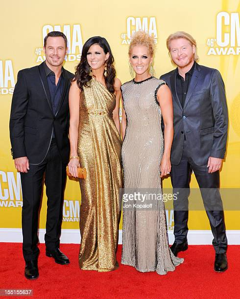 Recording Artists Jimi Westbrook Karen Fairchild Kimberly Schlapman and Phillip Sweet of Little Big Town attend the 46th annual CMA Awards at the...