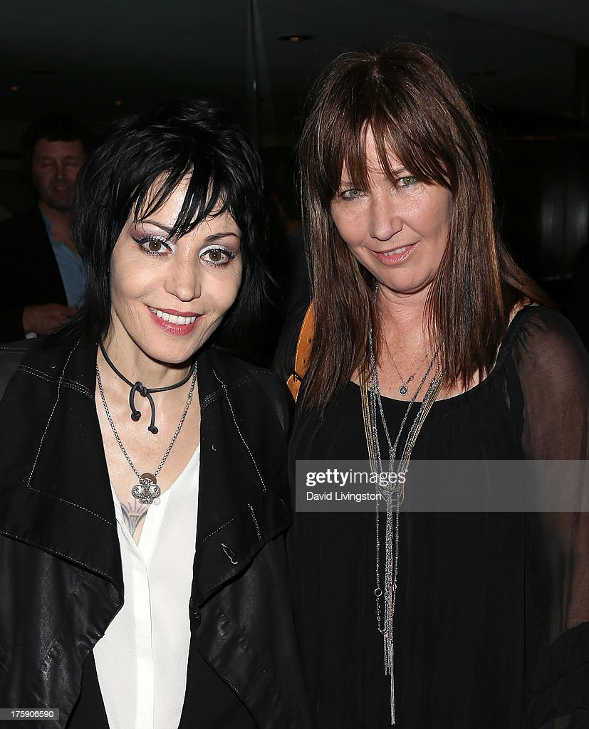 Recording artists <a gi-track='captionPersonalityLinkClicked' href=/galleries/search?phrase=Joan+Jett&family=editorial&specificpeople=213317 ng-click='$event.stopPropagation()'>Joan Jett</a> (L) and <a gi-track='captionPersonalityLinkClicked' href=/galleries/search?phrase=Kathy+Valentine&family=editorial&specificpeople=627951 ng-click='$event.stopPropagation()'>Kathy Valentine</a> attend the 'Hell in The City of Angels: Chris Stein' photo exhibition opening at the Morrison Hotel Gallery on August 9, 2013 in West Hollywood, California.