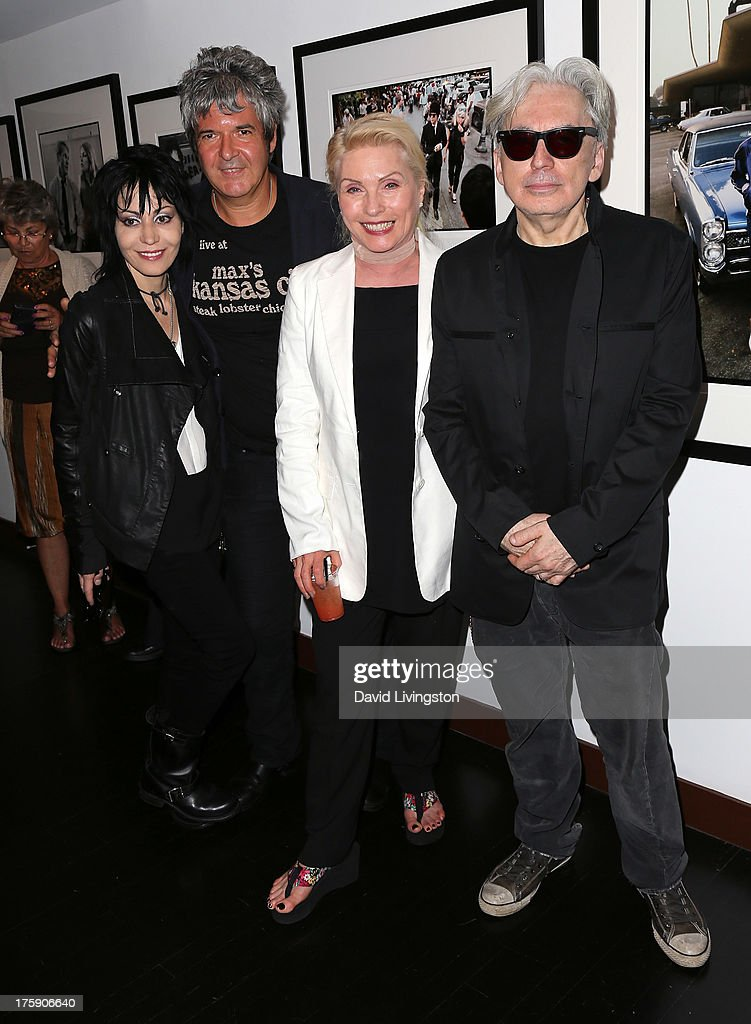 Recording artists <a gi-track='captionPersonalityLinkClicked' href=/galleries/search?phrase=Joan+Jett&family=editorial&specificpeople=213317 ng-click='$event.stopPropagation()'>Joan Jett</a>, <a gi-track='captionPersonalityLinkClicked' href=/galleries/search?phrase=Clem+Burke&family=editorial&specificpeople=618427 ng-click='$event.stopPropagation()'>Clem Burke</a>, <a gi-track='captionPersonalityLinkClicked' href=/galleries/search?phrase=Debbie+Harry&family=editorial&specificpeople=209145 ng-click='$event.stopPropagation()'>Debbie Harry</a> and <a gi-track='captionPersonalityLinkClicked' href=/galleries/search?phrase=Chris+Stein&family=editorial&specificpeople=239488 ng-click='$event.stopPropagation()'>Chris Stein</a> attend the 'Hell in The City of Angels: <a gi-track='captionPersonalityLinkClicked' href=/galleries/search?phrase=Chris+Stein&family=editorial&specificpeople=239488 ng-click='$event.stopPropagation()'>Chris Stein</a>' photo exhibition opening at the Morrison Hotel Gallery on August 9, 2013 in West Hollywood, California.