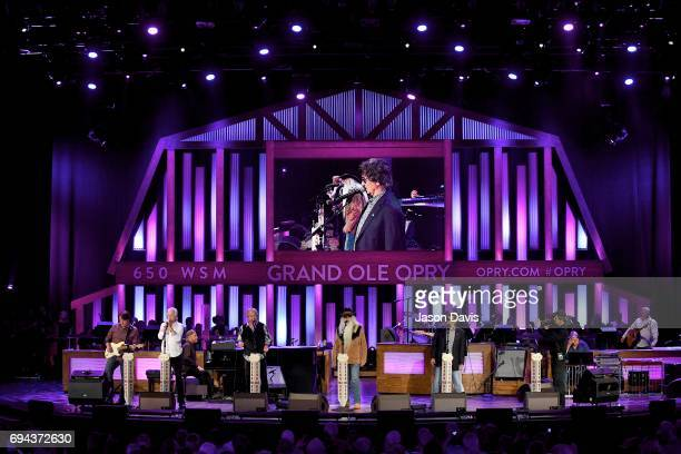 Recording Artists Joe Bonsall Duane Allen William Lee Golden and Richard Sterban of The Oak Ridge Boys perform onstage at The Grand Ole Opry on June...
