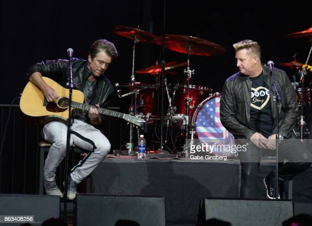Recording artists Joe Don Rooney and Gary LeVox of Rascal Flatts perform during 'Vegas Strong A Night of Healing' at the Orleans Arena on October 19...