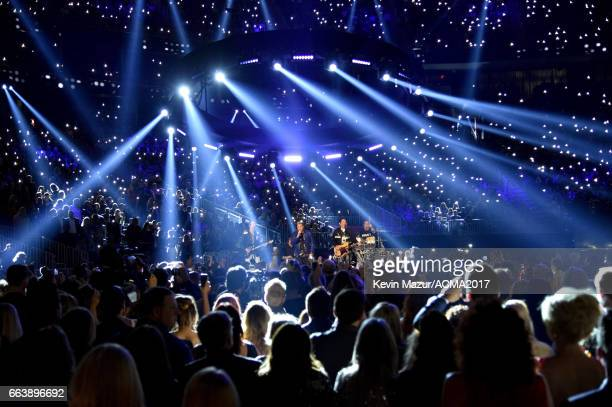 Recording artists Joe Don Rooney Gary LeVox and Jay DeMarcus of music group Rascal Flatts perform onstage during the 52nd Academy of Country Music...