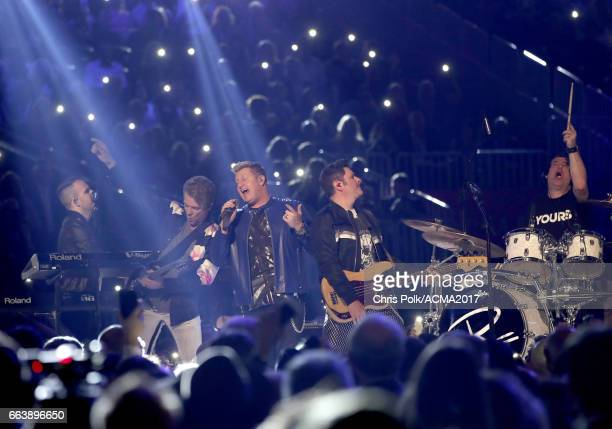 Recording artists Joe Don Rooney Gary LeVox and Jay DeMarcus of Rascal Flatts perform onstage during the 52nd Academy of Country Music Awards at...