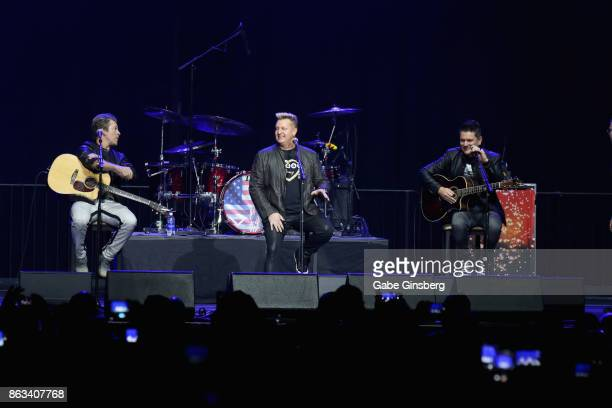 Recording artists Joe Don Rooney Gary LeVox and Jay DeMarcus of Rascal Flatts perform during 'Vegas Strong A Night of Healing' at the Orleans Arena...