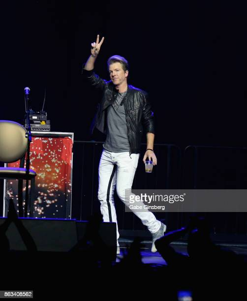 Recording artists Joe Don Rooney of Rascal Flatts walks onstage during 'Vegas Strong A Night of Healing' at the Orleans Arena on October 19 2017 in...