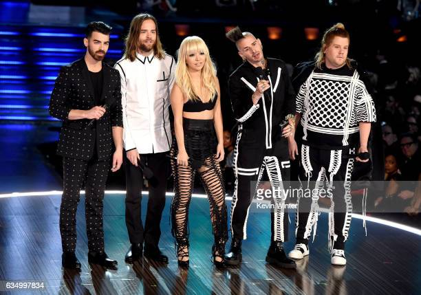 Recording artists Joe Jonas Jack Lawless JinJoo Lee and Cole Whittle of music group DNCE and host James Corden speak onstage during The 59th GRAMMY...