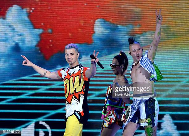Recording artists Joe Jonas JinJoo Lee and Cole Whittle of music group DNCE perform onstage during Nickelodeon's 2016 Kids' Choice Awards at The...