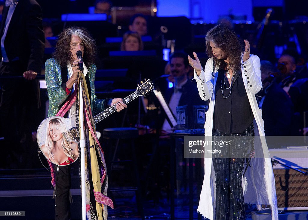 Recording artists <a gi-track='captionPersonalityLinkClicked' href=/galleries/search?phrase=Joe+Perry+-+M%C3%BAsico&family=editorial&specificpeople=13600677 ng-click='$event.stopPropagation()'>Joe Perry</a> and <a gi-track='captionPersonalityLinkClicked' href=/galleries/search?phrase=Steven+Tyler&family=editorial&specificpeople=202080 ng-click='$event.stopPropagation()'>Steven Tyler</a> perform at Hollywood Bowl Opening Night Gala - Inside at The Hollywood Bowl on June 22, 2013 in Los Angeles, California.