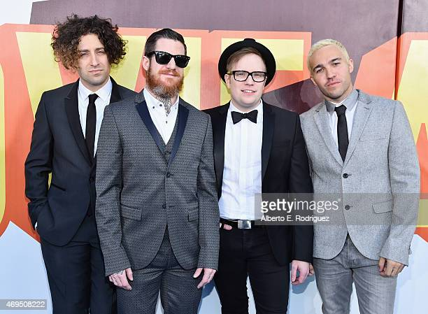 Recording artists Joe Trohman Andy Hurley Patrick Stump and Pete Wentz of music group Fall Out Boy attend The 2015 MTV Movie Awards at Nokia Theatre...