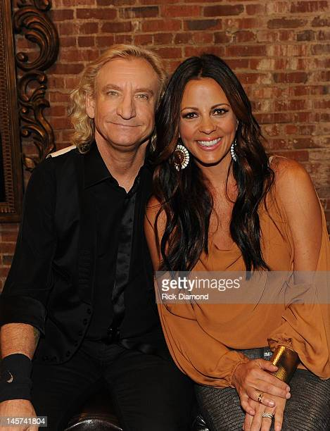 Recording Artists Joe Walsh and Sara Evans backstage after the taping of CMT Crossroads Joe Walsh Friends at Liberty Hall on May 30 2012 in Franklin...