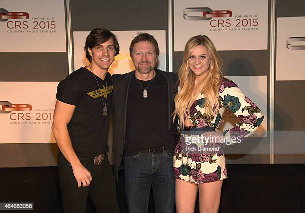 Recording artists John King Craig Morgan and Kelsea Ballerini pose backstage during the 3rd Annual Black River Entertainment Country Radio Seminar...