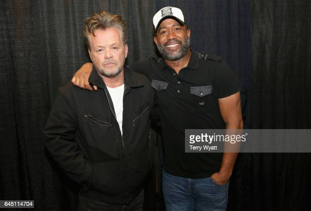 Recording artists John Mellencamp and Darius Rucker pose backstage during CMT Crossroads John Mellencamp and Darius Rucker on February 24 2017 in...