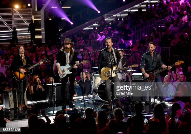 Recording artists John Osborne and TJ Osborne of music group Brothers Osborne perform onstage during the 52nd Academy of Country Music Awards at...