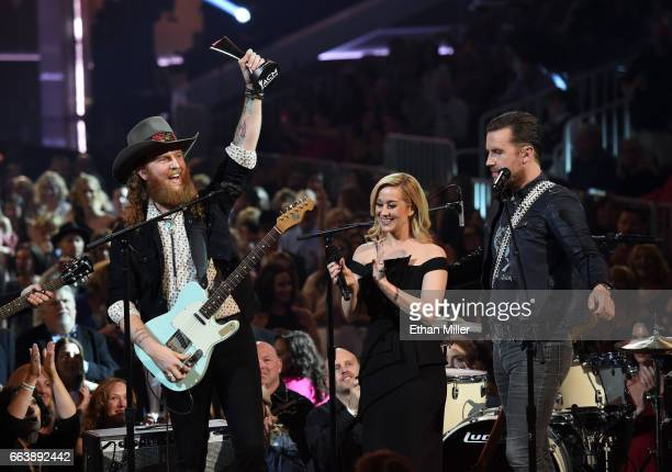 Recording artists John Osborne and TJ Osborne of music group Brothers Osborne accept the New Vocal Duo or Group Of The Year award presented by...