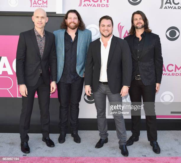 Recording artists Jon Jones James Young Mike Eli and Chris Thompson of music group Eli Young Band attends the 52nd Academy Of Country Music Awards at...