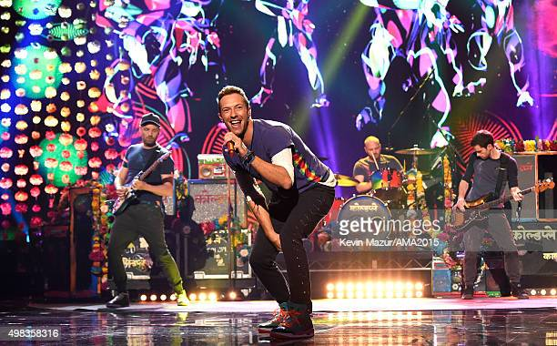 Recording artists Jonny Buckland Chris Martin Will Champion and Guy Berryman of music group Coldplay perform onstage during the 2015 American Music...