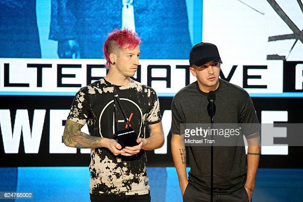 Recording artists Josh Dun and Tyler Joseph of the band Twenty One Pilots accept the award for Favorite Duo or Group Pop/Rock onstage during the 2016...