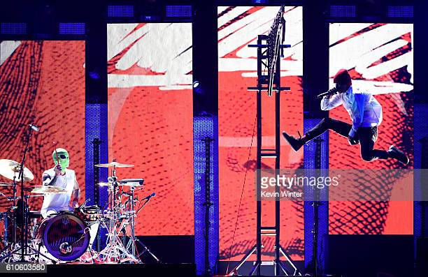Recording artists Josh Dun and Tyler Joseph of Twenty One Pilots perform onstage at the 2016 iHeartRadio Music Festival at TMobile Arena on September...
