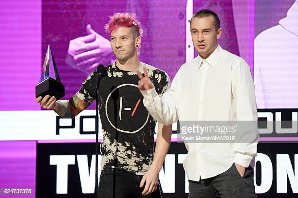 Recording artists Josh Dun and Tyler Joseph of Twenty One Pilots accept the Favorite Duo or Group award onstage at the 2016 American Music Awards at...