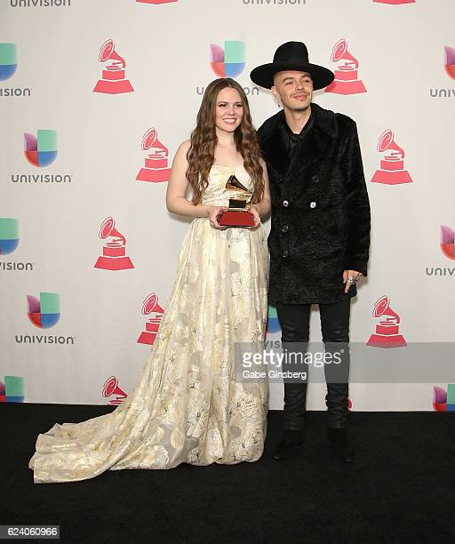 Recording artists Joy Huerta and Jesse Huerta of music group Jesse y Joy pose with the Best Contemporary Pop Vocal Album award in the press room...