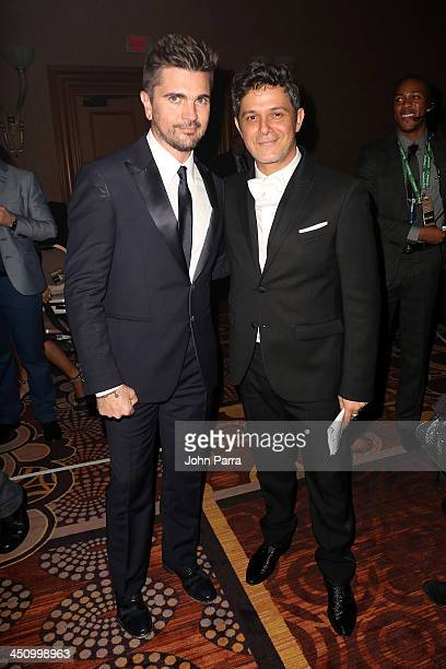 Recording artists Juanes and Alejandro Sanz pose backstage during the 2013 Person of the Year honoring Miguel Bose at the Mandalay Bay Convention...