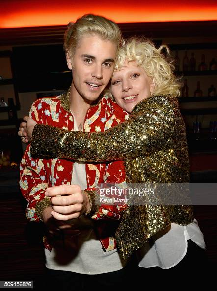 Recording artists Justin Bieber and Lady Gaga in Saint Laurent by Hedi Slimane attend Saint Laurent at the Palladium on February 10 2016 in Los...