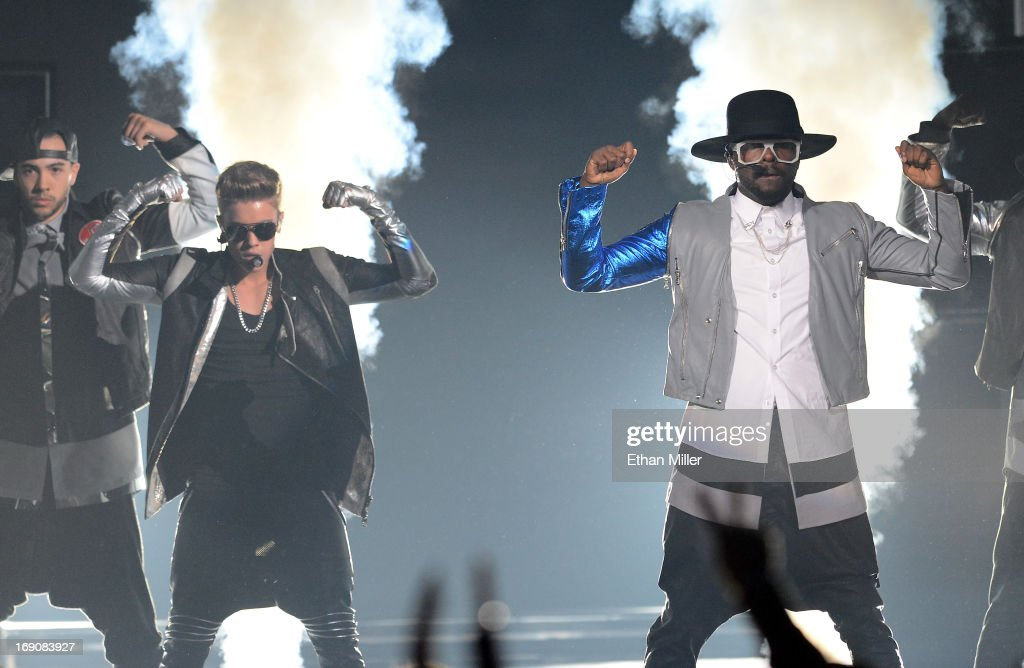 Recording Artists <a gi-track='captionPersonalityLinkClicked' href=/galleries/search?phrase=Justin+Bieber&family=editorial&specificpeople=5780923 ng-click='$event.stopPropagation()'>Justin Bieber</a> and Will.i.am perform onstage during the 2013 Billboard Music Awards at the MGM Grand Garden Arena on May 19, 2013 in Las Vegas, Nevada.
