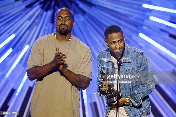 Recording artists Kanye West and Big Sean accept the Video with a Social Message award for 'One Man Can Change The World' onstage during the 2015 MTV...